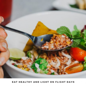 A person eating a healthy and light meal on flight days