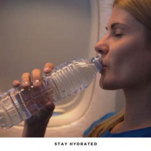Girl drinking water on a flight
