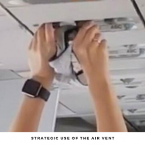 A person who is using the air vent