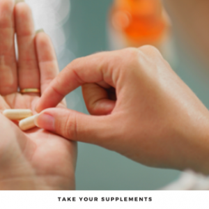 Person's hand with supplement