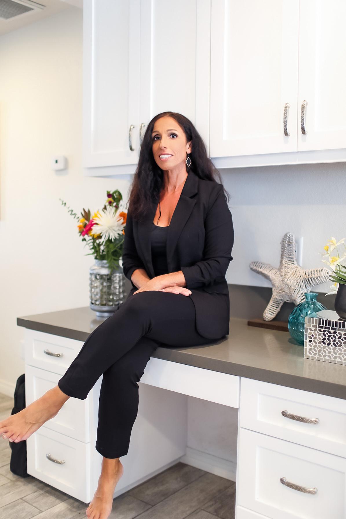 Dr. Michelle in a black suit