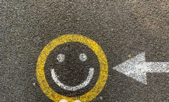smiley face on a road
