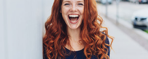 happy red hair woman